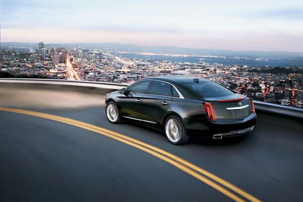 Cadillac XTS Premium MSRP: $54,670 | The Cadillac XTS Premium comes with a 14-speaker Bose surround sound system, climate control, adaptive forward lighting and 19-inch polished aluminum wheels.