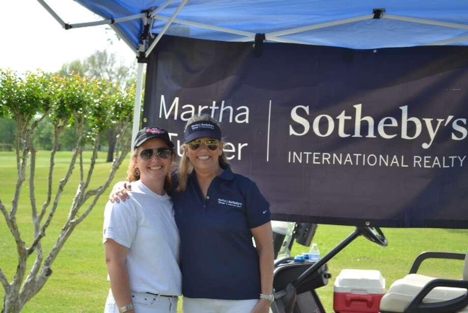 At the golf event were Beth Heineman (left) and MTSIR agent Kelley Austin.