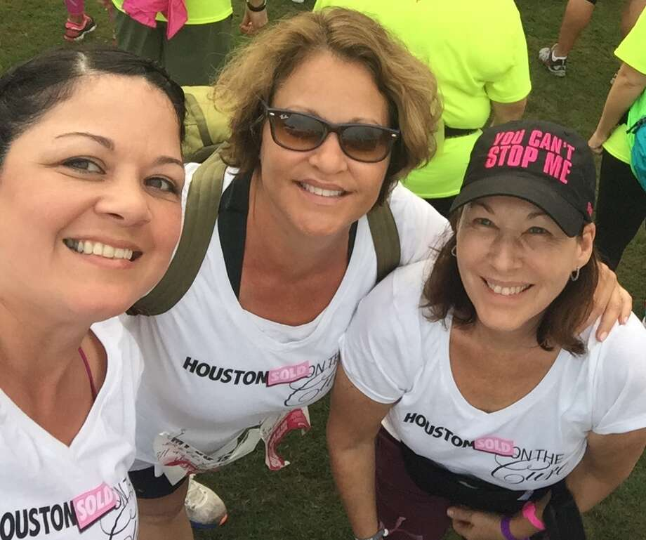 Samantha Ortiz, Debbie Pearce and Katie Charlton were part of the team of real estate professionals who participated in the Avon 39-mile walk. Photo: Picasa