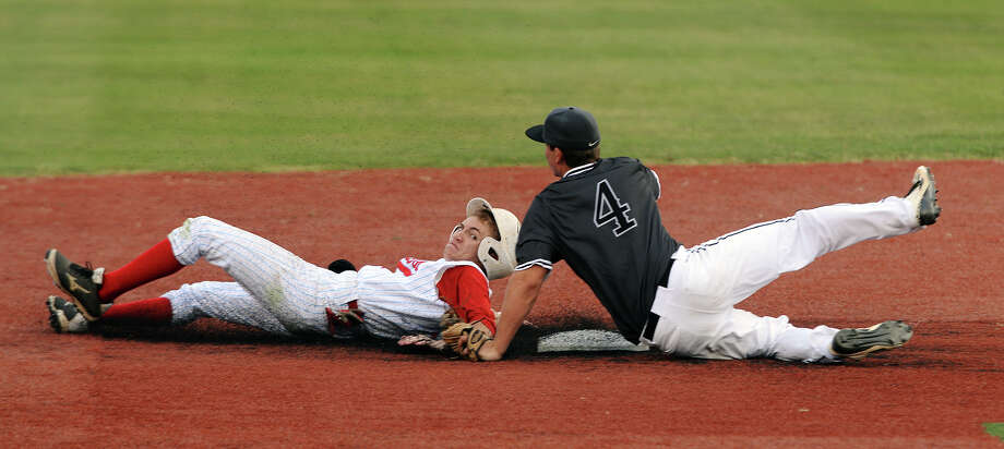 Lumberton's Tanner Weigand, No. 1, slides into second base past Kingwood Park's Blake Ledoux, No. 4, during Thursday's game. The Lumberton Raiders played the Kingwood Park Panthers at Vincent-Beck Stadium on Thursday in a 5A playoff game.  Photo taken Thursday 5/7/15  Jake Daniels/The Enterprise Photo: Jake Daniels / ©2015 The Beaumont Enterprise/Jake Daniels