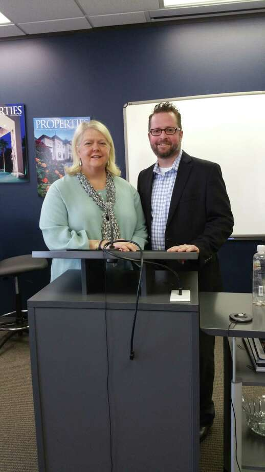 Marilyn Thompson, vice president of sales, is shown with Jason Cunningham, chief of appraisal for HCAD.