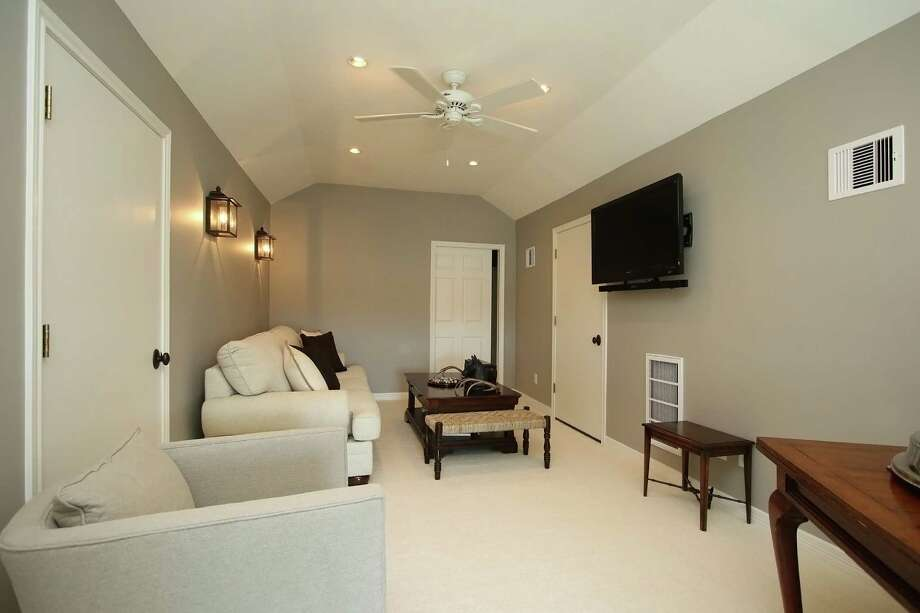 This remodeled attic space is by Remodelers of Houston.