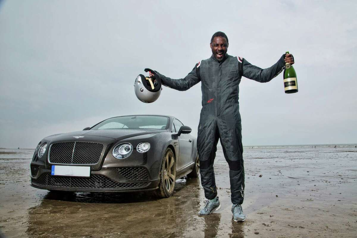"""He knows how to race cars. In fact, Elba is host of BBC America's """"King of Speed,"""" in which he examines the underground racing scene around the world. Here, he celebrates after achieving an average speed of 180.361mph to beat record set by Sir Malcolm Campbell in 1927."""