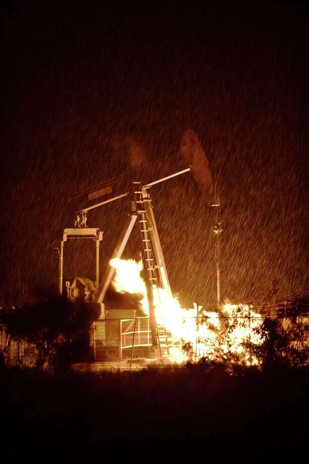A gas well on the Payne lease, operated by Vantage Energy, burns during a thunderstorm after severe weather and lightning moved across North Texas, Thursday, May 7, 2015, in Denton, Texas. (David Minton/The Denton Record-Chronicle via AP) Photo: David Minton, AP / The Denton Record-Chronicle
