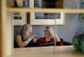 Therapists Traci Ruble (left) and Lily Sloane enjoy a light moment in Ruble's offices.  Both see problems with patients posting testimonials Thursday May 7, 2015 in San Francisco, Calif. Some local marriage and family therapists are concerned about patients posting their testimonials on websites like Yelp where online ratings could benefit or hurt a practice.