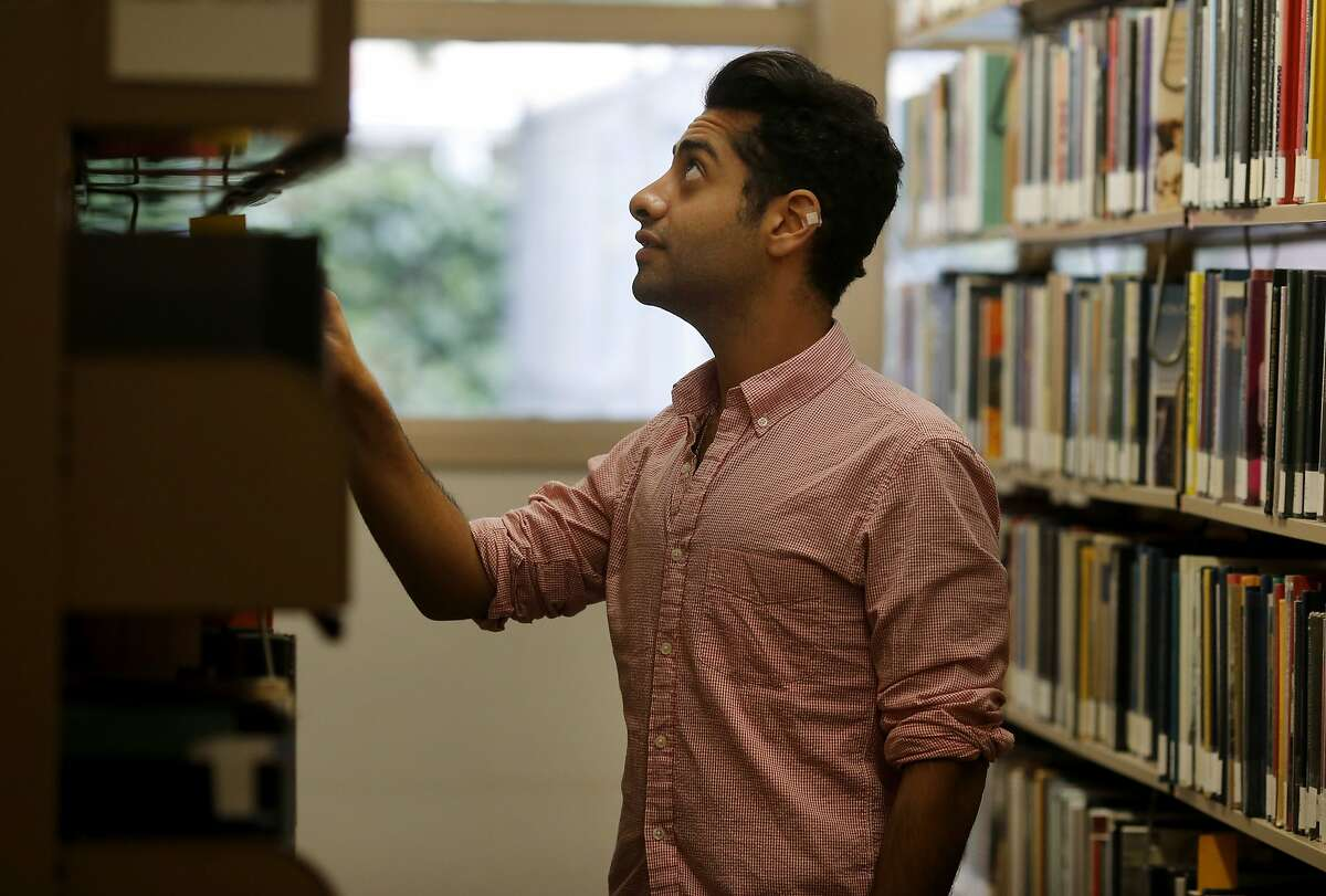 Abdulaziz Al-Saud, a Saudi prince, checks out some reading material at the college library Thursday May 7, 2015. More than 100 members of the Saudi Arabian royal family and other wealthy Saudis, mostly men, have graduated or attended Menlo College since 1963.