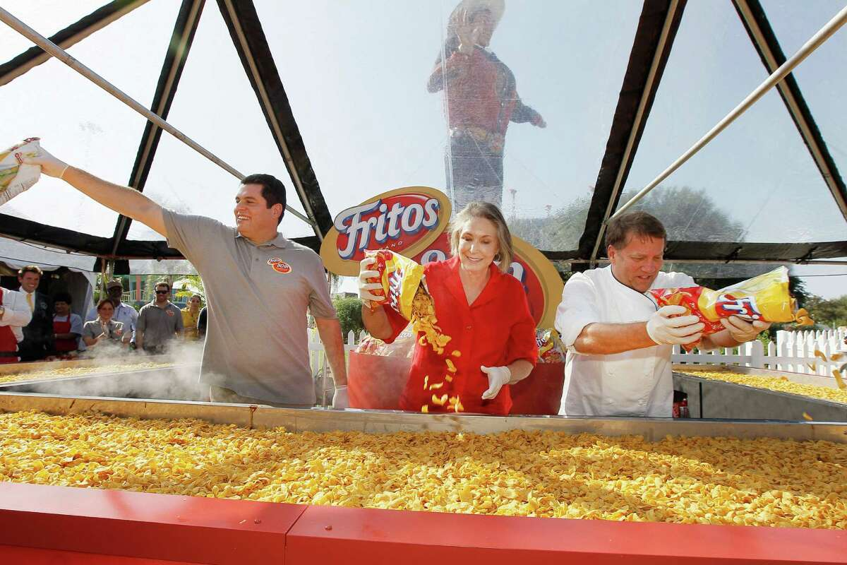 Tony Matta, vice president of marketing for Frito-Lay North America, Kaleta Doolin, daughter of Elmer Doolin, founder the Frito Company, and Jody Denton, executive chef at Frito-Lay North America, celebrate Fritos Corn Chips?• 80th anniversary by helping build the World's Largest Fritos Chili Pie, weighing in at more than 1,300 pounds, at the State Fair of Texas in Dallas, Texas, Monday, October 1, 2012.