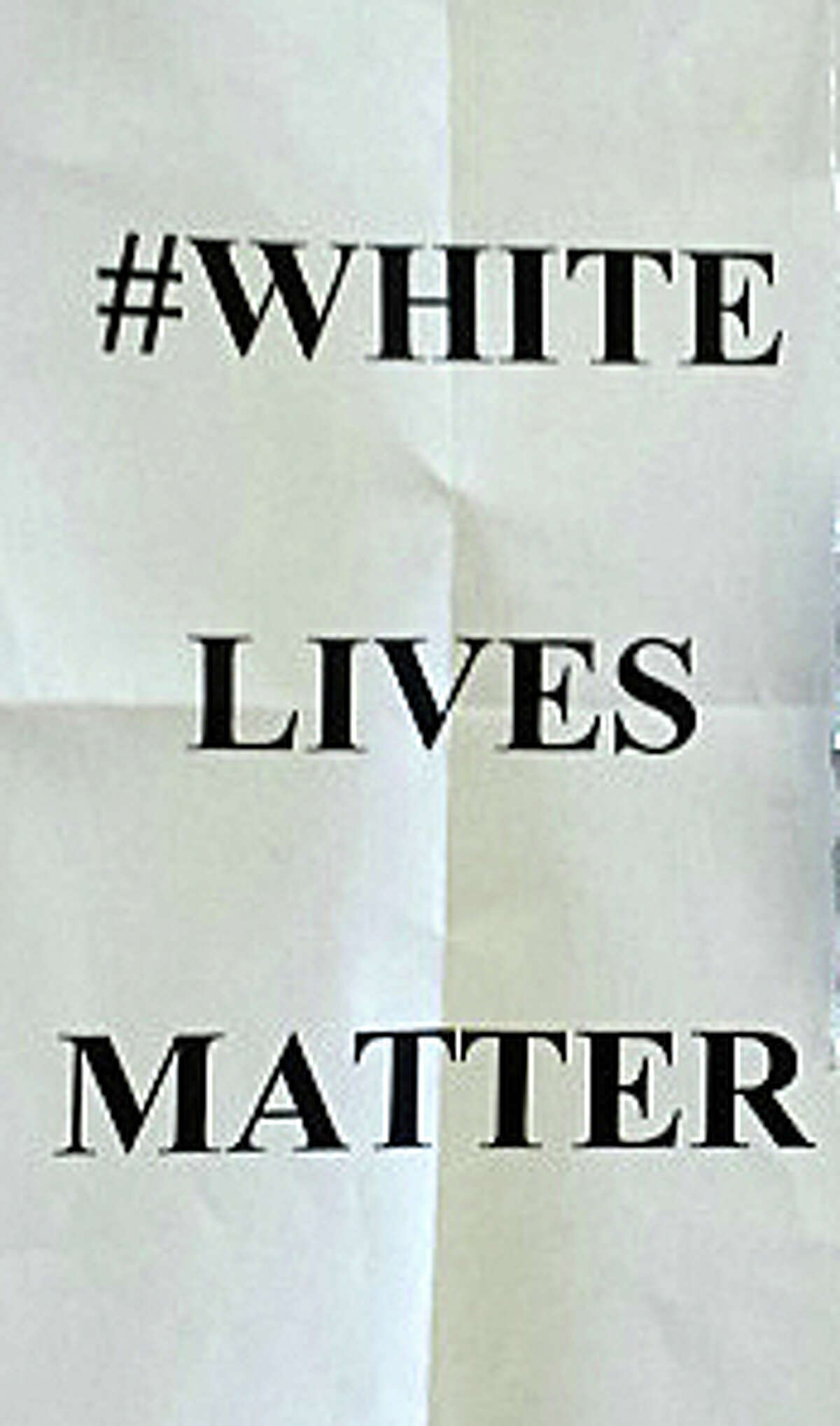"""Flyers with the message, """"#White Lives Matter,"""" an apparent response to the #Black Lives Matter hashtag widely used on social media after the deaths of young black men confronted by police, have been tossed on local lawns over the last few days."""