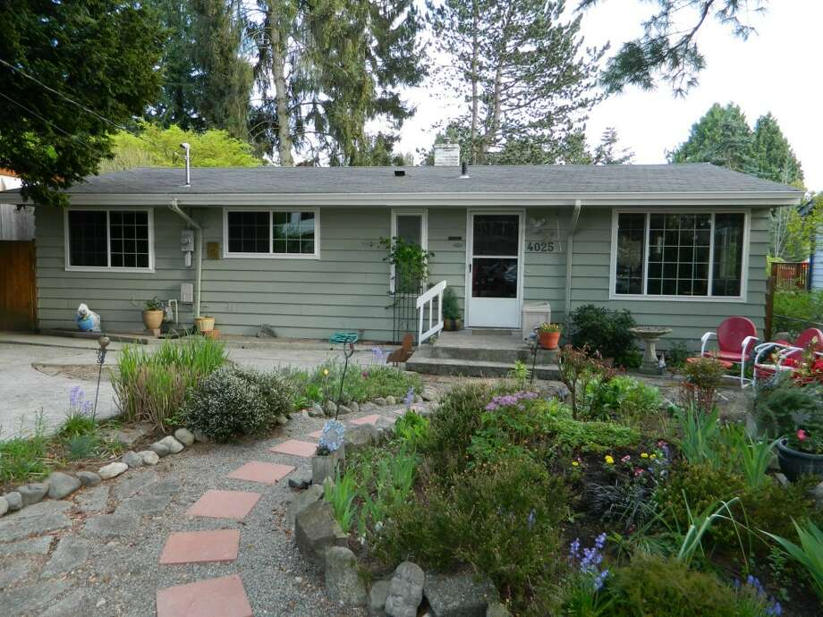 The first home, 4025 N.E. 115th St., is listed for $425,000. The two bedroom, one bathroom home features a beautifully landscaped backyard.