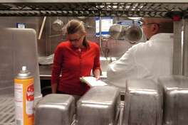 (CM) FDInspect_CM Kristi Kelley a public health inspector for Denver's Department of Environmental Health conducts a food inspection in the kitchen of the ESPN Zone in downtown Denver on Tuesday May 27, 2008. Cyrus McCrimmon, The Denver Post