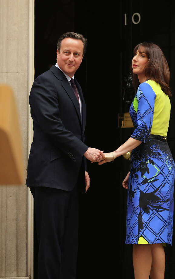 Prime Minister David Cameron is joined by his wife, Samantha, outside 10 Downing St. Photo: Christopher Furlong / Getty Images / 2015 Getty Images