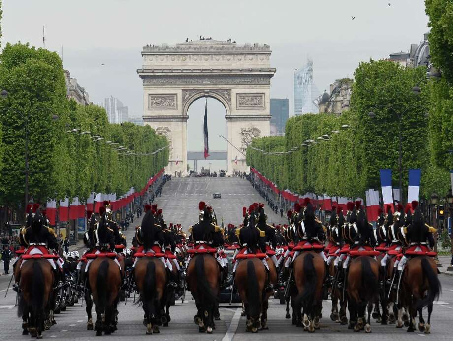 Horsemen of the French Republican Guard parade in Paris to mark victory over Nazi Germany during World War II. Photo: LOIC VENANCE / AFP / Getty Images / AFP