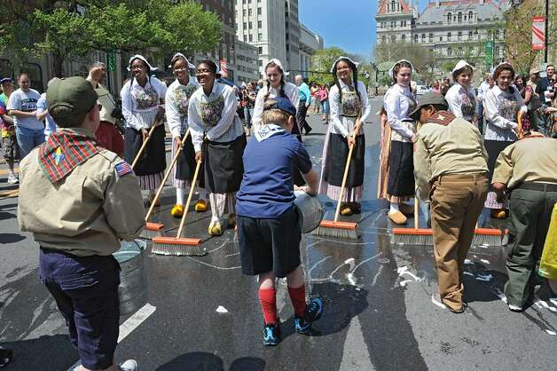 Albany Tulip Fest officially begins with the annual scrubbing of the streets. (Lori Van Buren / Times Union)