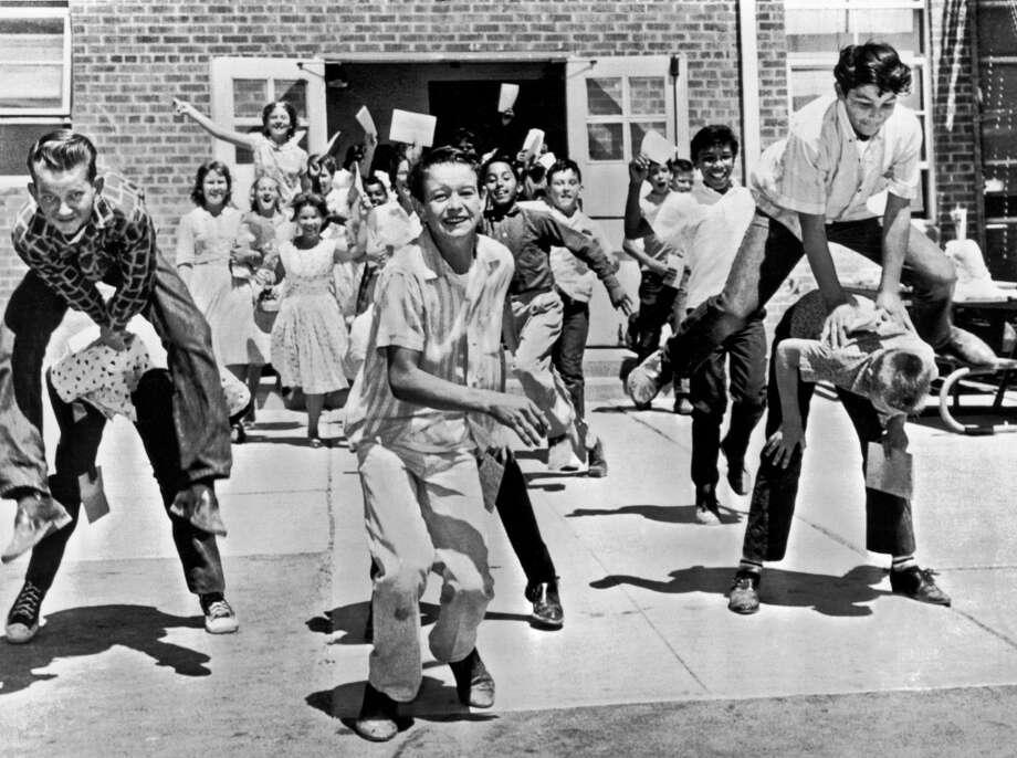 Seventh graders rejoice at the end of the school year, Phoenix, Arizona, 1962. Photo: Underwood Archives, Getty Images