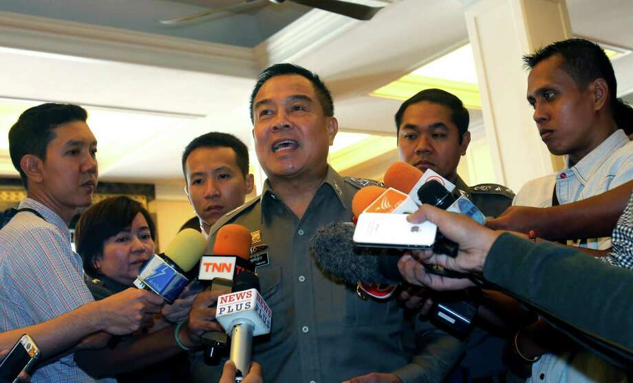 Thai Police chief Gen. Somyot Poompanmoung talks to reporters before a meeting about human trafficking in Bangkok. He said a powerful mayor was arrested and that more than 50 police officers were under investigation in the country's widening human-trafficking scandal. Photo: Sakchai Lalit / Associated Press / AP