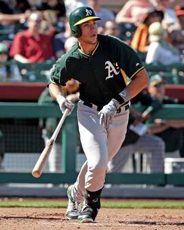 Oakland Athletics' Alex Hassan against San Francisco Giants in Spring Training Cactus League game at Scottsdale Stadium in Scottsdale, Arizona, on Wednesday, March 4, 2015.