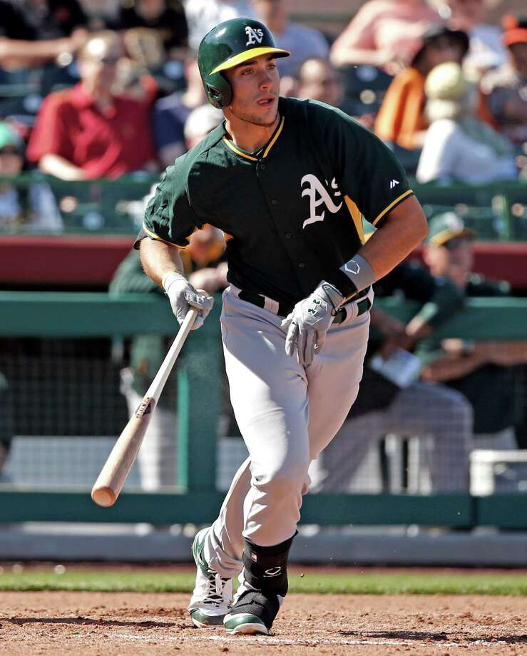 Oakland Athletics' Alex Hassan against San Francisco Giants in Spring Training Cactus League game at Scottsdale Stadium in Scottsdale, Arizona, on Wednesday, March 4, 2015. Photo: Scott Strazzante / The Chronicle / ONLINE_YES