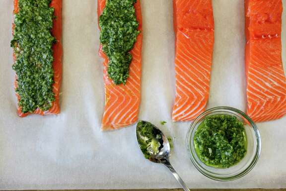 Slow-broiled salmon with an green herb, shallots, and oil rub.