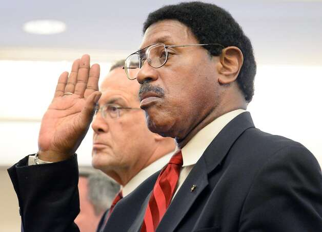 Assemblyman William Scarborough, right, is sworn in accompanied by his defense attorney E. Stewart Jones in Albany County Court Thursday May 7, 2015 in Albany, NY.  At left is Asst. AG Christopher Baynes and  is at right.  (John Carl D'Annibale / Times Union) Photo: Albany Times Union