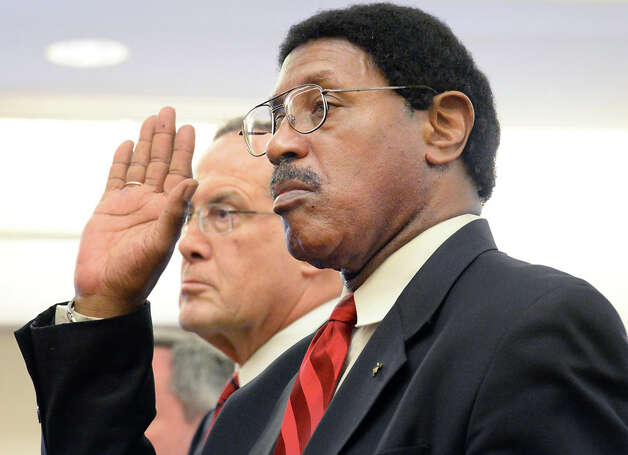 Assemblyman William Scarborough, right, is sworn in accompanied by his defense attorney E. Stewart Jones in Albany County Court Thursday May 7, 2015 in Albany, NY.  At left is Asst. AG Christopher Baynes and  is at right.  (John Carl D'Annibale / Times Union) Photo: John Carl D'Annibale, Albany Times Union / 00031749A
