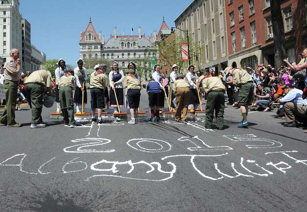 Senior young ladies from Albany High School and members of the Troop 2 Boy Scouts and Troop 605 Cub Scouts participate in the traditional street scrubbing on State St. as part of 167th annual Tulip Festival on Friday, May 8, 2015 in Albany, N.Y. (Lori Van Buren / Times Union) Photo: Lori Van Buren / 00031725A
