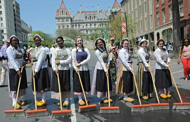 Senior students from Albany High School, from left, Kori Dobbs, Neshell Martin, Isabel Pottinger, Katherine Sharp, Antoinette Mastrangelo, Lauren Hartman, Elaine Thorton and Morganne McClement participate in the traditional street scrubbing on State St. as part of 167th annual Tulip Festival on Friday, May 8, 2015 in Albany, N.Y. (Lori Van Buren / Times Union) Photo: Lori Van Buren / 00031725A