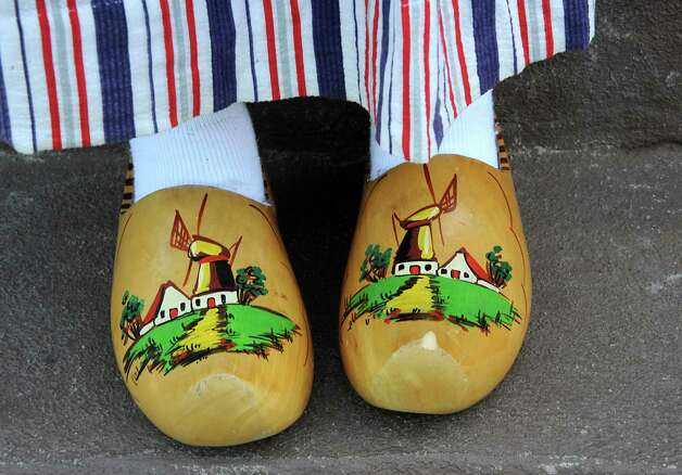 Senior student Kori Dobbs from Albany High School wears traditional wooden shoes from Holland as she participates in the traditional street scrubbing on State St. as part of 167th annual Tulip Festival on Friday, May 8, 2015 in Albany, N.Y. (Lori Van Buren / Times Union) Photo: Lori Van Buren / 00031725A