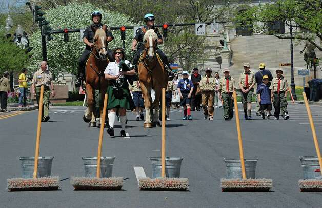 Participants make their way down State St. for the traditional street scrubbing to begin the 167th annual Tulip Festival on Friday, May 8, 2015 in Albany, N.Y. (Lori Van Buren / Times Union) Photo: Lori Van Buren / 00031725A
