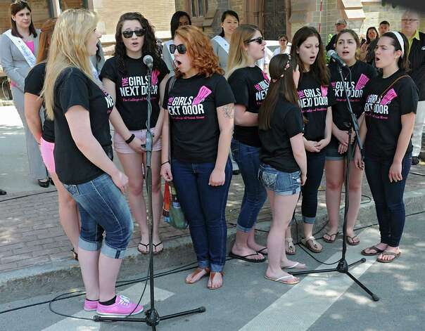 A group called The Girls Next Door from the College of St. Rose sings the National Anthem before the traditional street scrubbing on State St. as part of 167th annual Tulip Festival on Friday, May 8, 2015 in Albany, N.Y. (Lori Van Buren / Times Union) Photo: Lori Van Buren / 00031725A