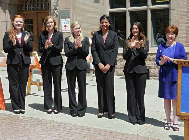 From left, this year's Tulip Court Sarah Wilamowski, Eva Petkanas, Jacqueline Murphy, Morgan Elizabeth Heyward and Alexandra Cronin stand with Albany Mayor Kathy Sheehan before the traditional street scrubbing on State St. as part of 167th annual Tulip Festival on Friday, May 8, 2015 in Albany, N.Y. (Lori Van Buren / Times Union) Photo: Lori Van Buren / 00031725A