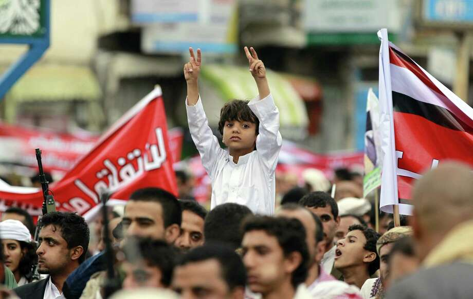 A Yemeni boy flashes the sign for victory during a demonstration for Shiite Houthi rebels in Sanaa. Photo: MOHAMMED HUWAIS / AFP / Getty Images / AFP