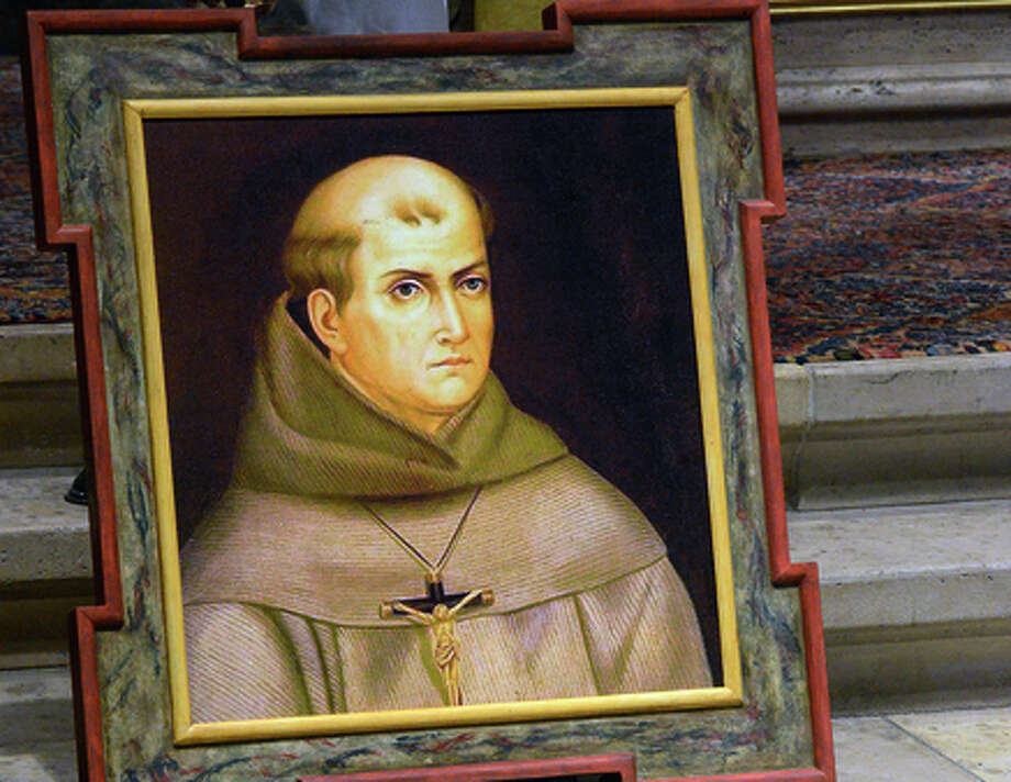 A painting of Rev. Junipero Serra has been placed above his grave inside the basilica at the Carmel Mission. The Vatican's saint-making office has officially given its thumbs up for Serra to be declared a saint. Photo: David Royal / Associated Press / The Monterey County Herald