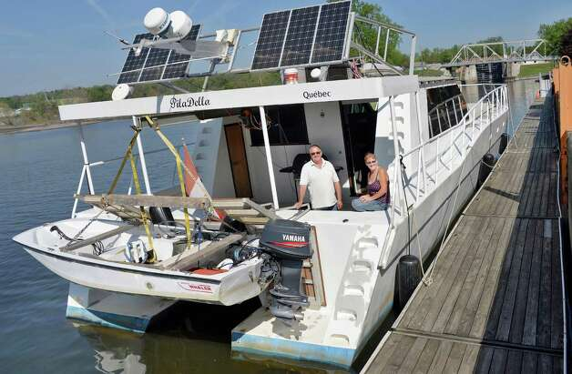 Pierre and Denise Lampron of Quebec dock their 55-ft. steel catamaran the Pila Della at the Waterford visitors center on their way home from a tour of the Bahamas as the New York State Canal System opens Friday May 8, 2015 in Waterford, NY.  (John Carl D'Annibale / Times Union) Photo: John Carl D'Annibale / 00031630A