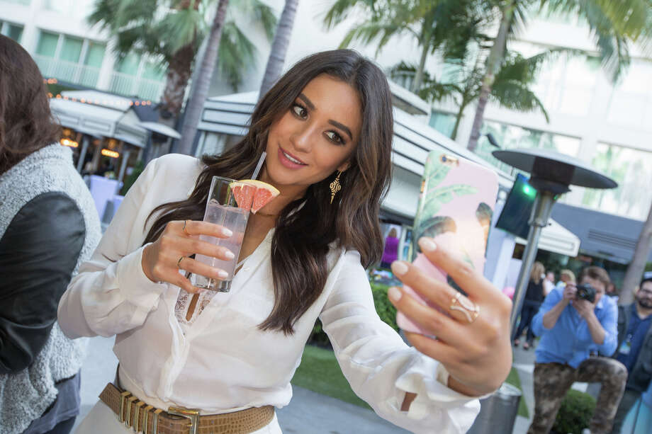 IMAGE DISTRIBUTED FOR PALM BREEZE - Actress and host Shay Mitchell snaps a selfie at the launch party for Palm Breeze, a new sparkling alcohol spritz from Mike's Hard Lemonade, Co., at the Viceroy Santa Monica, Saturday, April 25, 2015 in Santa Monica, Calif. Image released on Wednesday, April 29th, 2015.  (Jeff Lewis/AP Images for Palm Breeze) Photo: Jeff Lewis, FRE / AP Images
