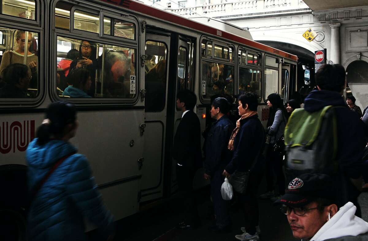 People crowd into the 30 - Stockston Muni bus before the stockton tunnel in San Francisco, Calif., Thursday May 7, 2015.