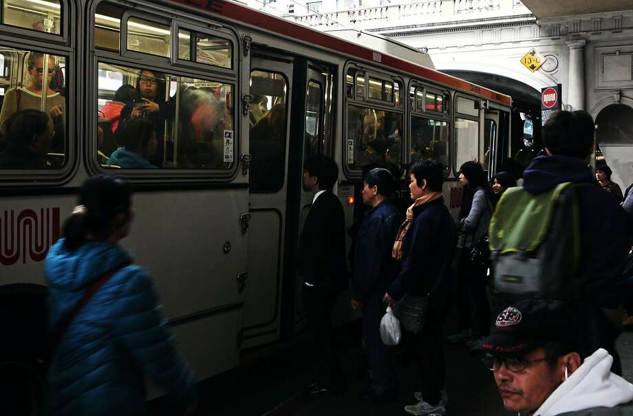 People crowd into the 30 - Stockston Muni bus before the stockton tunnel in San Francisco, Calif., Thursday May 7, 2015. Photo: Sophia Germer, The Chronicle