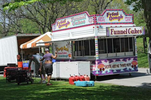 Food vendors start to set up in Washington Park during the start of the 167th annual Tulip Festival on Friday, May 8, 2015 in Albany, N.Y. (Lori Van Buren / Times Union) Photo: Lori Van Buren / 00031725A