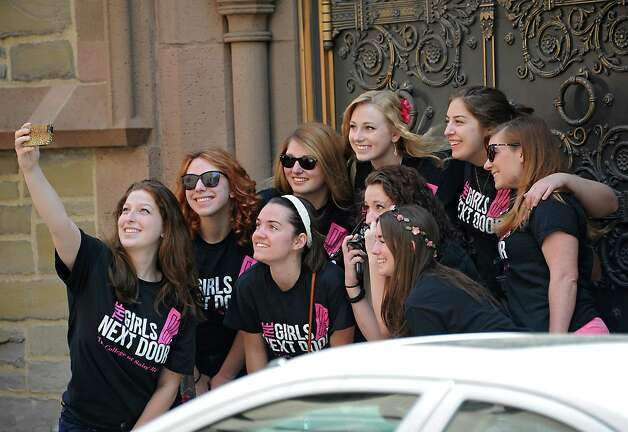 A group called The Girls Next Door from the College of St. Rose takes a selfie before they perform the National Anthem before the traditional street scrubbing on State St. as part of 167th annual Tulip Festival on Friday, May 8, 2015 in Albany, N.Y. (Lori Van Buren / Times Union) Photo: Lori Van Buren / 00031725A
