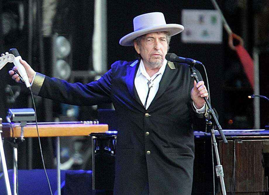 Bob Dylan, pictured in 2012, no longer allows photography during his concerts, which often are performed on mostly dark stages. Photo: David Vincent /Associated Press / AP