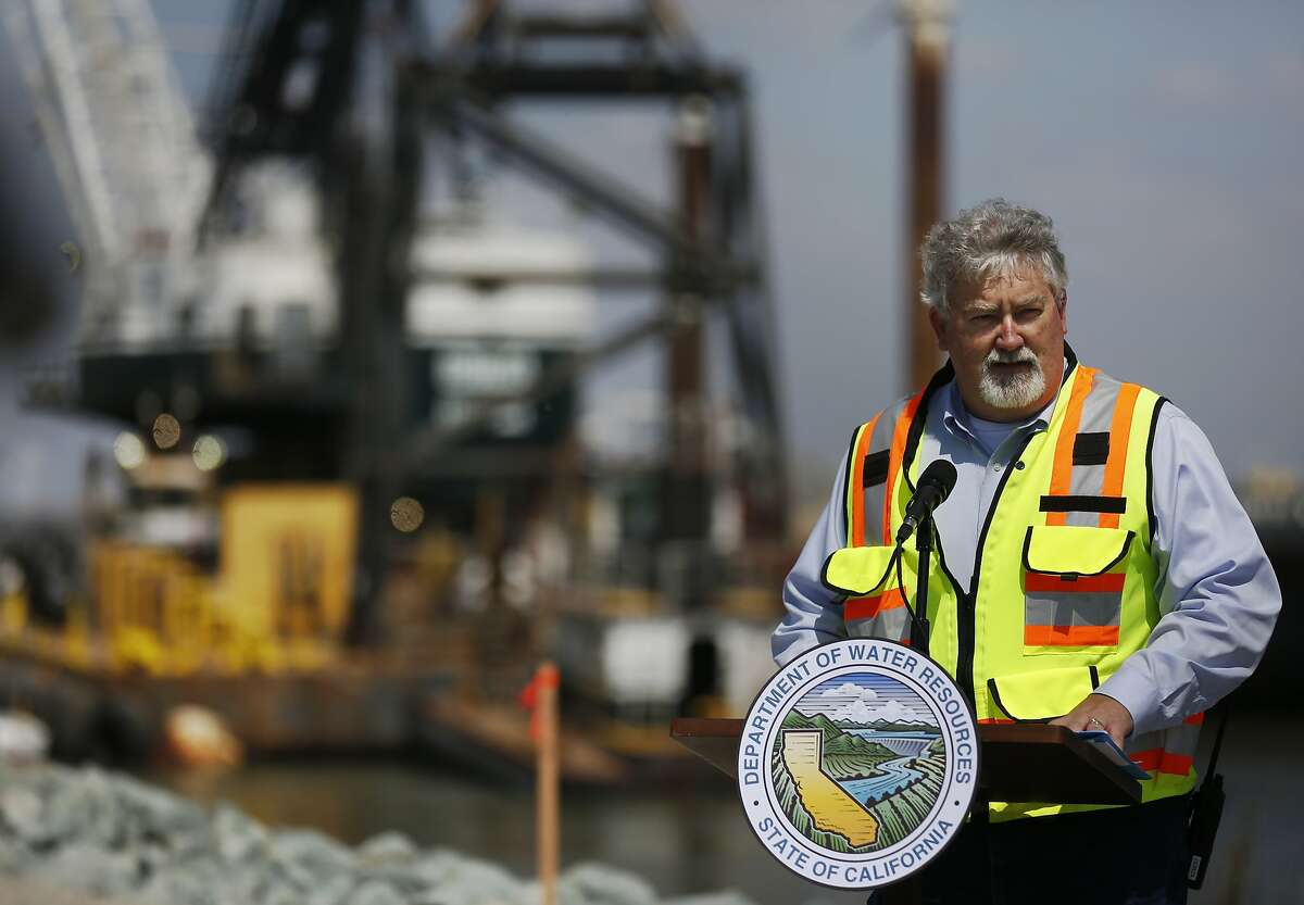 California Department of Water Resources Drought Manager Bill Croyle speaks to the media in front of the barrier construction site during a DWR press conference to announce the installation of an emergency barrier in the West False River to deter tidal saltwater from entering the central Delta May 8, 2015 in Oakley, Calif. Because officials expect that there will be little water to spare this summer for water releases from reservoirs to keep salt levels down, they decided to construct the temporary barrier. Construction will continue through June and the barrier will be removed in November to allow for fish migrations.