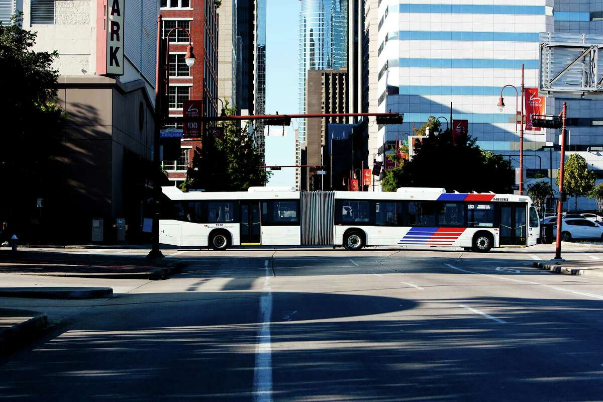 An articulated METRO bus drives down Congress Street at Louisiana Street Monday, Oct. 7, 2013, in Houston.