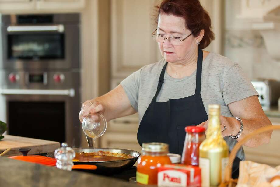 Chef Suzette Gresham adds a fresh cracked egg to the sauce pan for her Italian Tomato Egg dish. Burlingame, California at Riggs Distributing, Inc., Tuesday, March 17, 2015 Photo: Tina Case, Special To The Chronicle