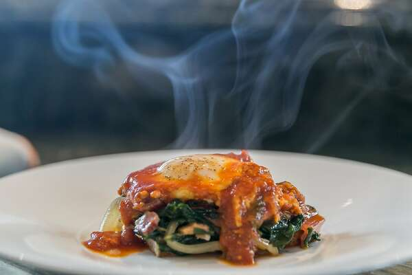 A steamy, hot plate of Italian Tomato Egg with chard by Chef Suzette Gresham. Burlingame, California at Riggs Distributing, Inc., Tuesday, March 17, 2015