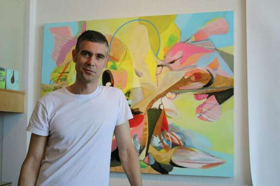Artist and master leaseholder Robert Donald stands in Studio 17 on 3265 17th St. April 18, 2015.