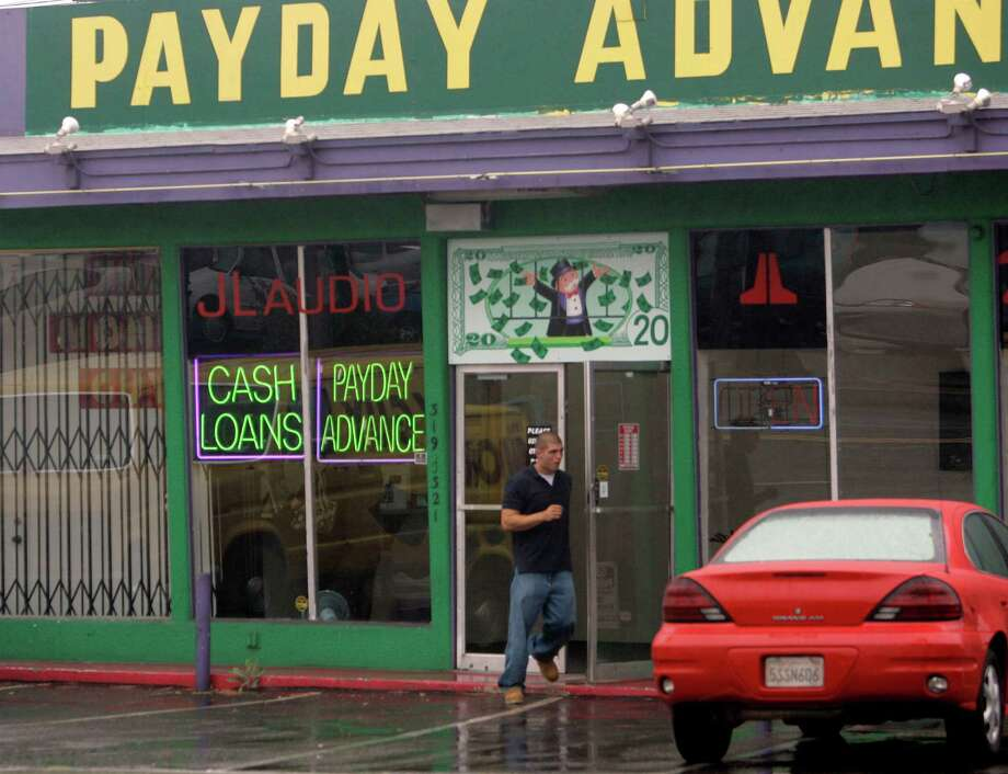 Texans should urge their federal and state lawmakers to tighten the rules on payday lenders who often charge huge interest rates on finanically strapped borrowers. Photo: LENNY IGNELZI /AP / AP