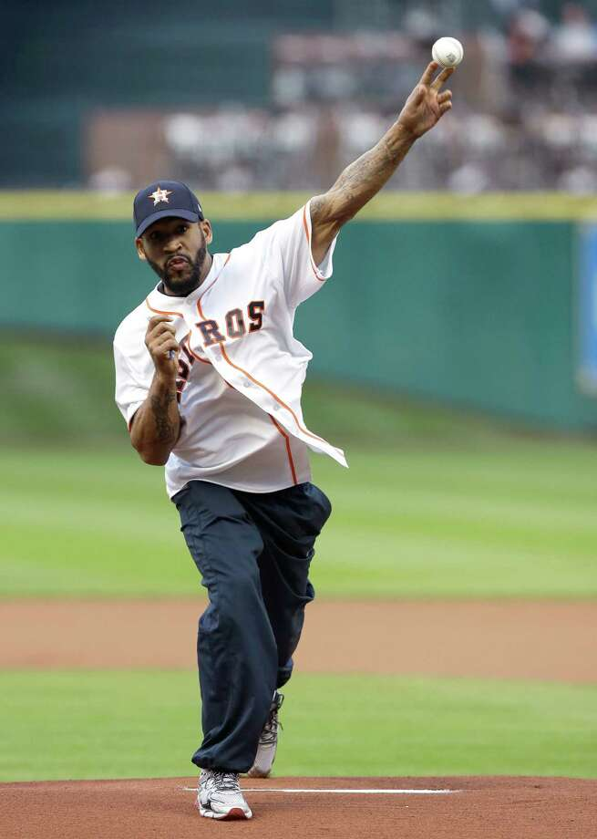 Fighter James Kirkland throws out a ceremonial first pitch before a baseball game between the Houston Astros and the Texas Rangers Wednesday, May 6, 2015, in Houston. (AP Photo/Pat Sullivan) Photo: Pat Sullivan, STF / Associated Press / AP