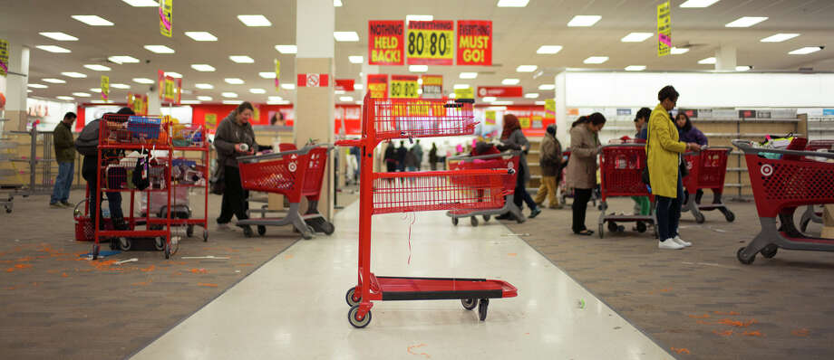 An empty shopping cart sits in a Target store in Toronto, days before the retail chain closed all 133 locations in Canada last month. Photo: IAN WILLMS / New York Times / NYTNS
