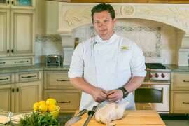 Chef Tyler Florence gets ready to demonstrate his famous fried chicken. Burlingame, California at Riggs Distributing, Inc., Friday March 27, 2015.