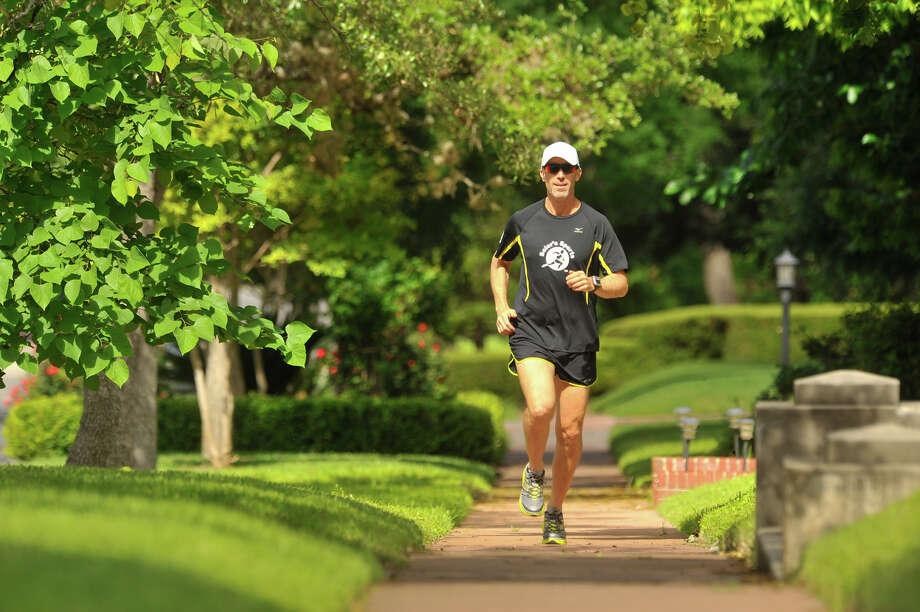 Restauranteur Andrew Weissman gets in a run through his Monte Vista neighborhood. Photo: Robin Jerstad / San Antonio Express-News