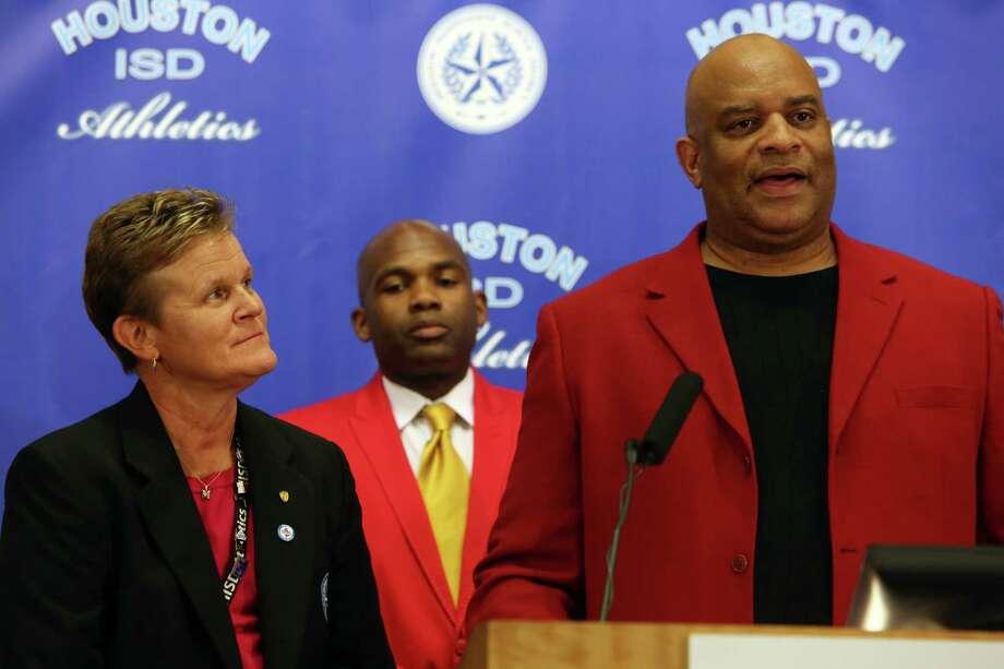 HISD Director of Athletics Marmion Dambrino, left, Yates Principal Donetrus Hill and Yates Head Basketball Coach Greg Wise shown in 2014 Photo: Mayra Beltran, Houston Chronicle / © 2014 Houston Chronicle